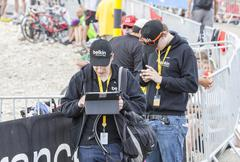 People Using Modern Electronic Devices to Transmit Data - Tour de France 2013 Stock Photos