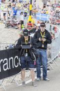 People Using Modern Electronic Devices to Transmit Data - Tour de France 2013 - stock photo