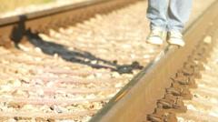Teenager balancing on the rails Stock Footage
