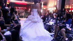 Model on the catwalk in wedding dress Stock Footage