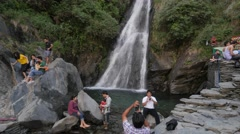 Tourists making photo's at waterfall,McLeod Ganj,Himachal Pradesh,India Stock Footage