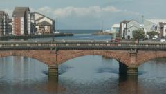 Vehicles crossing Ayr Bridge, Scotland (panning up) Stock Footage