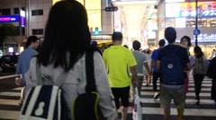 Thai women walk cross over road at crosswalk go to Dotonbori in Osaka, Japan Stock Footage