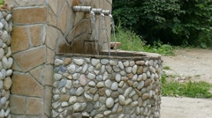 Roadside fountain in the Rhodope Mountains - Bulgaria. Stock Footage