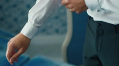 Elegant man straightens his shirt sleeves Stock Footage