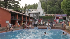 Pilgrims swim in pool at temple,McLeod Ganj,Himachal Pradesh,India Stock Footage