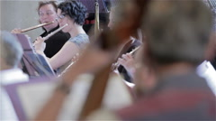 Orchestra rehearsal: pull focus from flutes to double bass - stock footage
