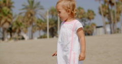 Cute Blond Girl at the Beach on a Tropical Weather Stock Footage