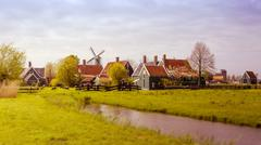 Windmill and rural houses in Zaanse Schans. Tilt-shift effect. - stock photo