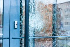 Broken glass front door - stock photo