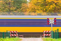 Dutch train passing a crossing - stock photo
