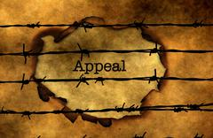 Appeal  text against barbwire Stock Photos