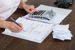Close-up Of Accountant Calculating Receipt In Office Stock Photos