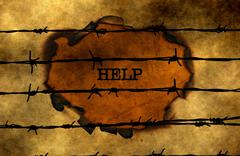 Help concept against barbwire Stock Photos
