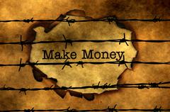 Make money concept against barbwire Stock Photos