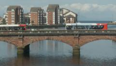 Vehicles crossing Ayr Bridge, Scotland (R to L Pan) Stock Footage