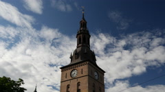 Tilt down from the Oslo Cathedral to a tram passing by Stock Footage