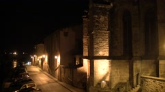 Small village at night with its church in France Stock Footage