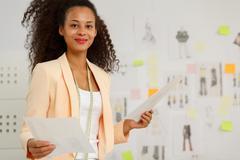 Stock Photo of Businesswoman in fashion design atelier