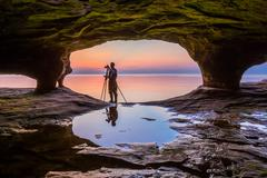 Stock Photo of Sea Cave Photographer at Sundown