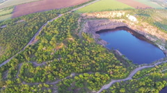 Flight top panorama  over   lake in pit and  river Aerial Stock Footage