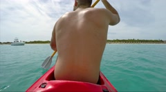 Stock Video Footage of Guy Paddling a Small Canoe in Caribbean Islands