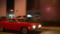 Red Muscle Car Cruising on Road - stock footage