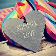 Stock Photo of colorful flip-flops and text summer love, slight vignette added