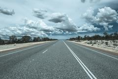 Endless straight highway outback Australia - stock photo