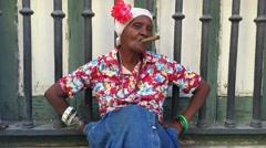 Cuban woman smoking cigar in Havana, Cuba Stock Footage