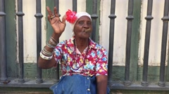 Cuban woman smoking cigar in Havana, Cuba - stock footage