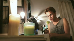Young Male Drag Queen Putting Makeup in Preparation for Entertainment Show Stock Footage