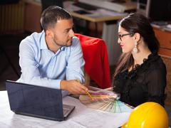 Team of architects working in the office and looking at color choices - stock photo