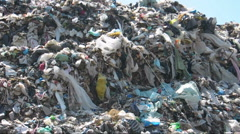 Trash wave. Illegal landfill above fields. - stock footage