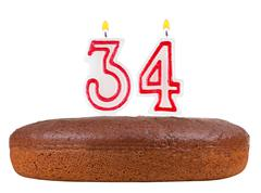 Birthday cake with candles number 34 Stock Photos