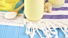 Freshly made pineapple ginger smoothie with Greek yogurt and juice. Stock Footage