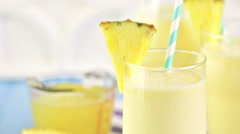 Freshly made pineapple ginger smoothie with Greek yogurt and juice. - stock footage