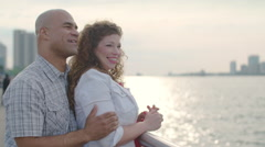 Happy couple talk and walk from the Detroit River 4K Stock Footage