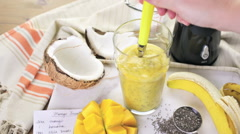 Freshly made mango banana smoothie with chia seeds. Stock Footage