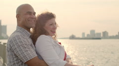 Happy couple in golden light by the Detroit River 4K - stock footage