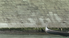 Tourists in gondolas under Ponte di Rialto bridge Stock Footage