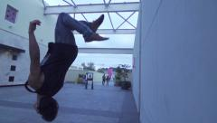 Slow Motion Wall Back Flip in Shopping Mall - stock footage