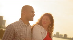 Happy couple in warm light by the Detroit River 4K Stock Footage