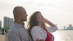 Laughing couple in slow motion by the Detroit River 4K Stock Footage