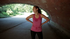 Girl Hands on Hips Breathing Heavy and Sweaty taking break Exercise - Long Shot - stock footage