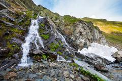 River watterfall flowing over rough rocks - stock photo