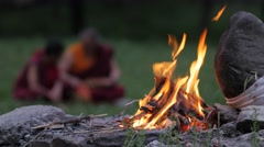 Buddhist teacher and student with focus on fire,Rewalsar,Himachal Pradesh,India Stock Footage