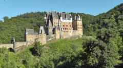 View of Eltz castle (German: Burg Eltz) surrounded by the Eltz forest Stock Footage