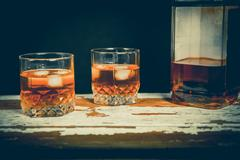 Whiskey on the rocks, vintage photos, booze culture Stock Photos