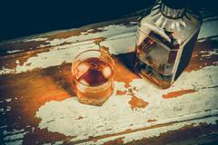 Whiskey on the rocks, vintage photos, booze culture - stock photo